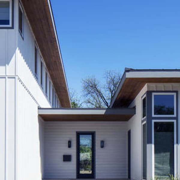 https://www.crystalexteriors.com/wp-content/uploads/2020/04/CRYSTALEXTERIORS-James-Hardie-HARDIEPANEL-VERTICAL-SIDING.jpg